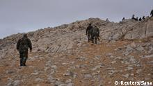 02.03.2017 *** Forces loyal to Syria's President Bashar al-Assad walk atop of a hill on the edge of Palmyra in this handout picture provided by SANA on March 2, 2017, Syria. SANA/Handout via REUTERS ATTENTION EDITORS - THIS PICTURE WAS PROVIDED BY A THIRD PARTY. REUTERS IS UNABLE TO INDEPENDENTLY VERIFY THE AUTHENTICITY, CONTENT, LOCATION OR DATE OF THIS IMAGE. FOR EDITORIAL USE ONLY.