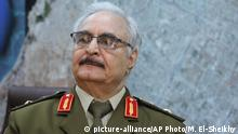 FILE -- In this March 18, 2015 file photo, Gen. Khalifa Hifter, Libya's top army chief, speaks during an interview with The Associated Press in al-Marj, Libya. The National Oil Corporation says it hopes to resume exports from Ras Lanuf, al-Sidra and Zueitina oil terminals seized on Sunday, Sept. 11, 2016, by forces loyal to Hifter, who is allied with the internationally recognized parliament. (AP Photo/Mohammed El-Sheikhy, File)  