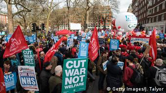 Protesters holding placards gather during a demonstration in support of the NHS in Tavistock Square (Getty Images/J. Talyor)