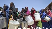 March 4, 2017*** FILE - In this Saturday, Feb. 25, 2017 file photo, displaced Somali girls who fled the drought in southern Somalia stand in a queue to receive food handouts at a feeding center in a camp in Mogadishu, Somalia. Somalia's prime minister said Saturday, March 4, 2017 that 110 people have died from hunger in the past 48 hours in a single region as a severe drought threatens millions of people. (AP Photo/Farah Abdi Warsameh, File)  