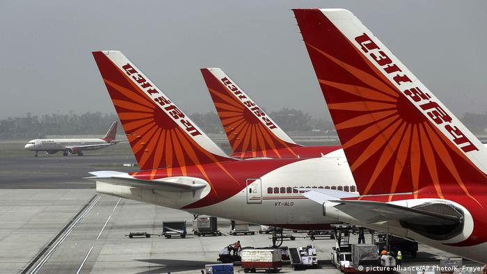 Passenger jets from Air India, India's national carrier, stand at Indira Gandhi International Airport