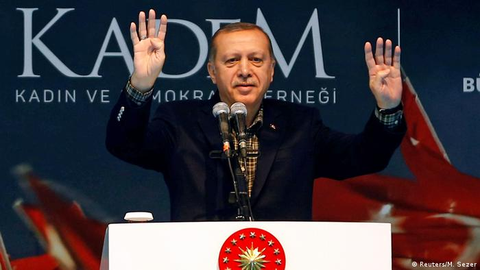 Turkish President Tayyip Erdogan greets his supporters during a Women's Day rally in Istanbul