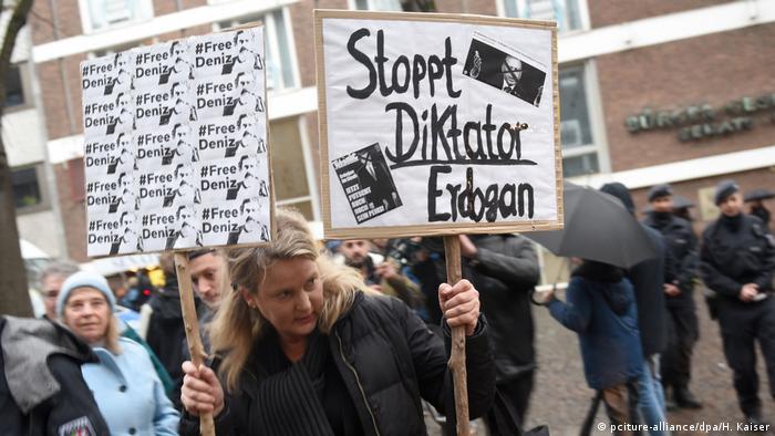 Protestors outside the Senat hotel in Cologne