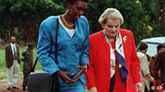 Rose Kabuye and Madeline Albright walking through a Rwandan cemetery