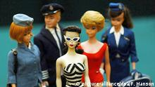 One of the Barbie number 1's (centre), the first Barbie doll model created in 1959 by Ruth Handler, co-founder of Mattel, at Christie's in London where she will be auctioned, estimated at £700-£1,200, on September 26th with 4000 Barbie dolls from the Ietje Raebel and Marina Collection, one of the most complete collections in existence. The other dolls are Barbies and a Ken doll from the Cabin Crew edition, which was issued as a group of three estimated to fetch around £400 for the group and a Bubble Cut Barbie, which were issued in identical pairs, estimated at around £300 for the pair. Foto: Fiona Hanson +++(c) dpa - Report+++ |