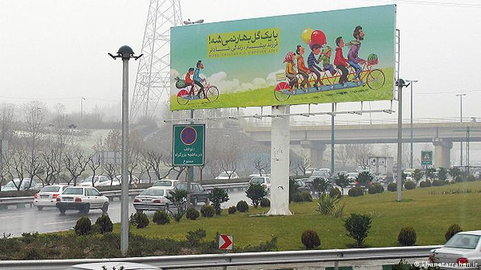 A billboard in Iran that promoted a slogan: More children, greater happiness