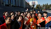 07.03.2017***** A group of women who arrived to collect their award ahead of upcoming Women's Day take a picture of themselves outside the Great Hall of the People where sessions of the National People's Congress (NPC) are taking place, in Beijing, China March 7, 2017. REUTERS/Tyrone Siu