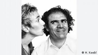 TV host and author Amelie Fried whispering to a man (H. Koebl)