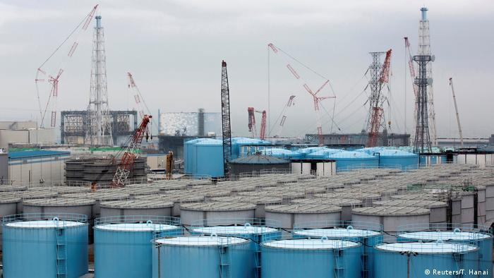 Blue and grey containers and cranes at Fukushima six years after the accident