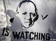 Pancarta con la imagen del ministro del Interior alemán, Wolfgang Schäuble.