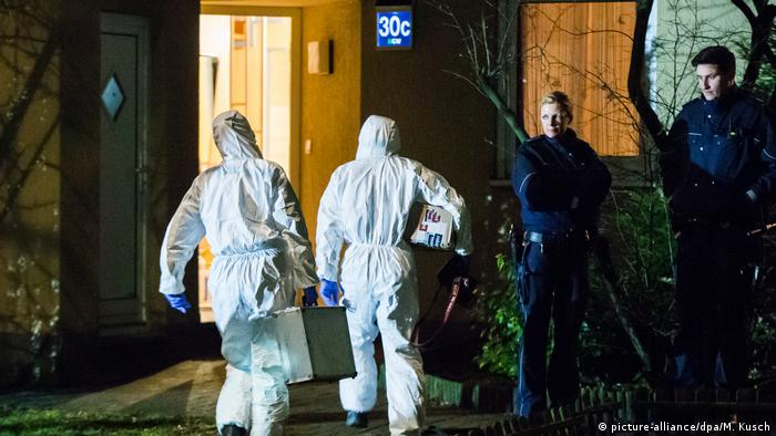 Police investigators enter the crime scene