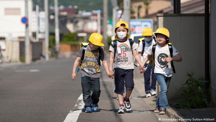 Children walking hand in hand in Fukushima (Greenpeace/Jeremy Sutton-Hibbert)