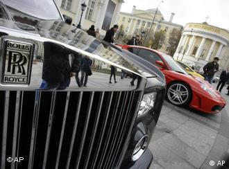 Cars are on display outside the Manezh exhibition hall where the Extravaganza 2008 exhibition, a luxury lifestyle show, opened in Moscow