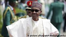 FILE - In this Friday, May 29, 2015 file photo, Nigerian President elect, Muhammadu Buhari, arrives for his Inauguration at the eagle square in Abuja, Nigeria. When Nigerian President Muhammadu Buhari left for London on Jan. 19 on a month-long medical leave he handed power to Vice President Yemi Osinbajo, a 59-year-old lawyer and pastor who has been empowered to attack the country's problems with an energy that has surprised observers and led some to suggest he should stay in charge for good.(AP Photo/Sunday Alamba, File) |