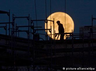 Man standing in front of moon