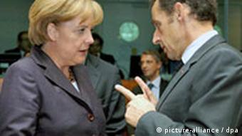 German Chancellor Angela Merkel, left, chats with French President Nicolas Sarkozy