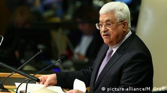Mahmoud Abbas speaking at a podium