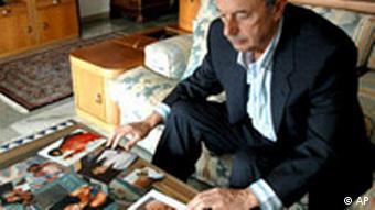 Beppino Englaro, father of Eluana Englaro, shows pictures of his daughter