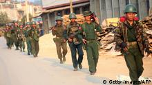 Myanmar soldiers patrol in Laukkai, the main city in the Kokang region of northern Myanmar Shan state, on February 16, 2015. Growing fighting between Myanmar's Army and ethnic Kokang fighters in a region bordering China has killed dozens in the past week and sent tens of thousands fleeing across the frontier, reports said on February 16. AFP / STRINGER (Photo credit should read -/AFP/Getty Images)
