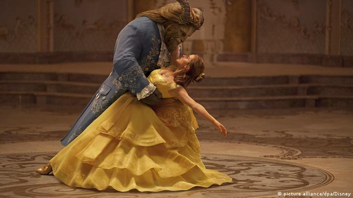 Scene from 'Beauty and the Beast' with a dancing beast and a young woman (picture alliance/dpa/Disney)