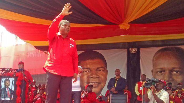 Angola's presidential candidate of the ruling MPLA party Joao Lourenco waves to supporters