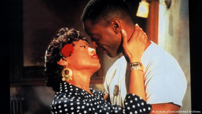 Film still 'Girl 6' with Theresa Randle and Isaiah Washington about to kiss.