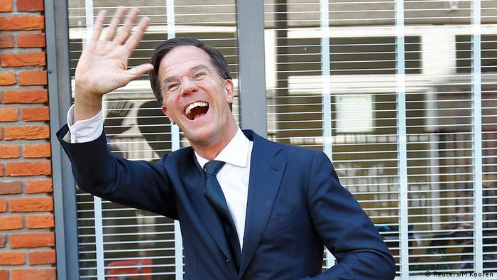 Dutch Prime Minister Mark Rutte of the VVD party waves after voting in the general election