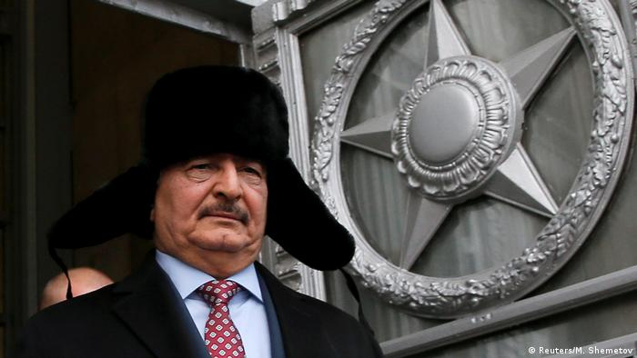 General Khalifa Haftar, commander in the Libyan National Army, wears a Russian hat after a meeting in Moscow
