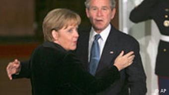 Bush and Merkel embrace