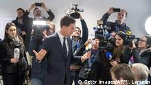 15.03.2017 *** Netherlands' prime minister and VVD party leader Mark Rutte speaks to journalists after casting his ballot for Dutch general elections at a polling station on March 15, 2017 in The Hague. Millions of Dutch voters were going to the polls March 15 in key elections overshadowed by a blazing diplomatic row with Turkey, with all eyes on the fate of far-right MP Geert Wilders. Following last year's shock Brexit vote, and Donald Trump's victory in the US presidential polls, the Dutch general elections are seen as a litmus test of the strength of far-right and populist parties ahead of other ballots in Europe this year. / AFP PHOTO / ANP / Jerry Lampen / Netherlands OUT (Photo credit should read JERRY LAMPEN/AFP/Getty Images)