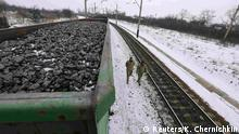 14.02.2017 *** FILE PHOTO: Activists walk along carriages loaded with coal from the occupied territories which they blocked at Kryvyi Torets station in the village of Shcherbivka in Donetsk region, Ukraine, February 14, 2017. REUTERS/Konstantin Chernichkin/File Photo