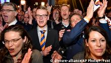 15.03.2017 Supporters of Prime Minister Mark Rutte of the free-market VVD party cheer during Rutte's first appearance after exit poll results of the parliamentary elections were announced in The Hague, Netherlands, Wednesday, March 15, 2017. (AP Photo/Patrick Post)
