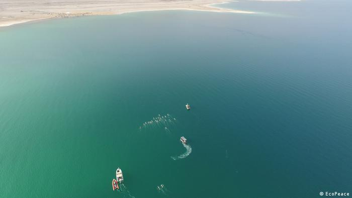 A boat and swimmer in the Dead Sea