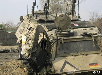 A damaged vehicle belongs to German International Security Assistance Force is seen near the site after a suicide attack on a NATO convey in Baghlan, Afghanistan, Sunday,Nov 16, 2008.