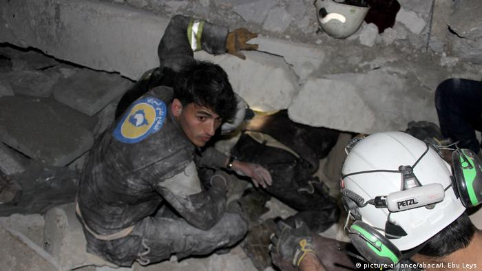 Paramedics search for survivors after airstrikes hit a mosque in a rebel-held city