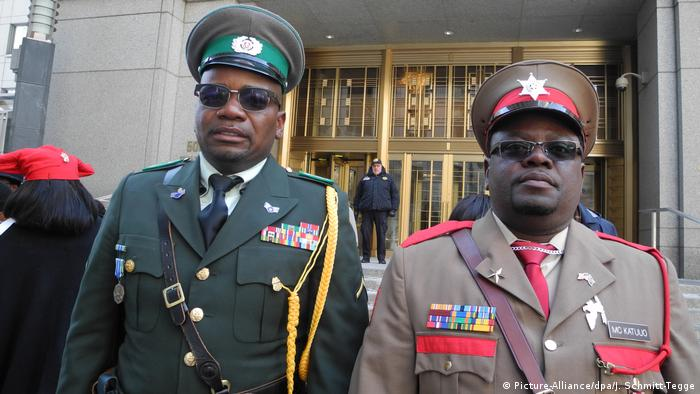 Reagan Kamboua and Victor Mc Katuro, Herero living in the US, in full military regalia, in front od the New York court where the class-action suit against Germany was filed.
