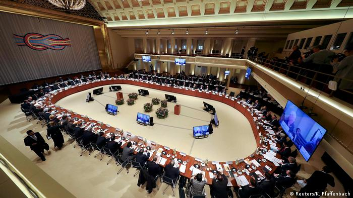 The large, oval conference table used for the 2016 meeting of G20 finance ministers (Reuters/K. Pfaffenbach)