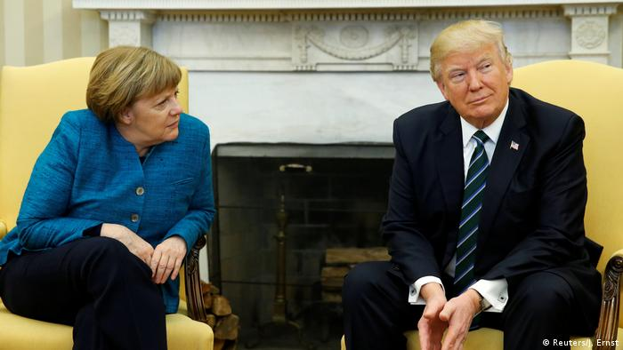 Merkel and Trump sit uncomfortably in two chairs during meeting in the White House (Reuters/J. Ernst)