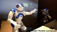 A receptionist robot performs during a demonstration for the media at the new hotel, aptly called Henn na Hotel or Weird Hotel, in Sasebo, southwestern Japan, Wednesday, July 15, 2015. From the receptionist that does the check-in and check-out to the porter that¿s a stand-on-wheels taking luggage up to the room, the hotel, that is run as part of Huis Ten Bosch amusement park, is ¿manned¿ almost totally by robots to save labor costs. (AP Photo/Shizuo Kambayashi) |