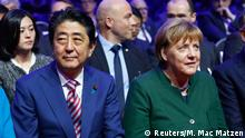 19.3.2017*** German Chancellor Angela Merkel and Japanese Prime Minister Shinzo Abe attend the opening ceremony of the CeBit computer fair, which will open its doors to the public on March 20, at the fairground in Hanover, Germany, March 19, 2017. REUTERS/Morris Mac Matzen