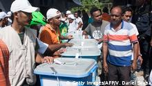 East Timorese people stand next to ballot boxes that will be distributed for the upcoming presidential elections in Dili on March 19, 2017. East Timor goes to the polls on March 20 for the first round of voting. / AFP PHOTO / VALENTINO DARIEL SOUSA (Photo credit should read VALENTINO DARIEL SOUSA/AFP/Getty Images)
