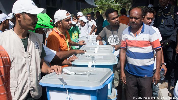 East Timorese voters next to ballot boxes for the presidential elections in Dili on March 19.