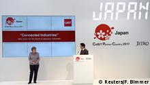 20.03.2017****Japanese Prime Minister Shinzo Abe and German Chancellor Angela Merkel at the Japan booth during a media tour of the world's biggest computer and software fair, CeBit, in Hanover, Germany, March 20, 2017. REUTERS/Fabian Bimmer