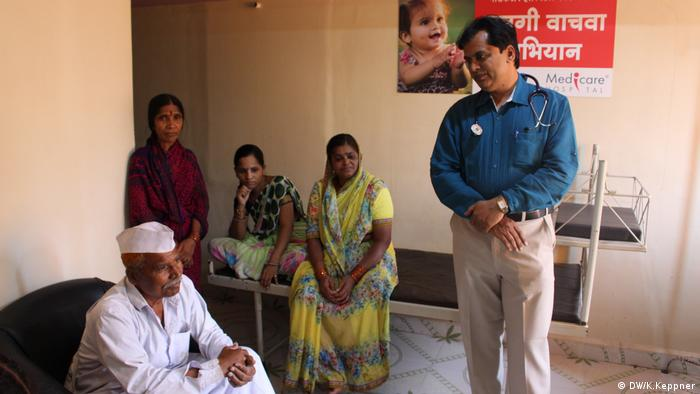 Dr Ganesh Rakh with the family of a patient in his hospital