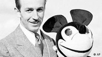 Walt Disney and a Mickey Mouse doll in 1935