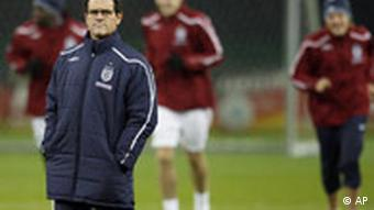 Coach Fabio Capello, front is seen during an England training session in Berlin.
