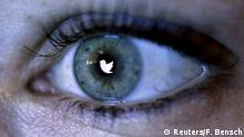 FILE PHOTO - An illustration picture shows the Twitter logo reflected in the eye of a woman in Berlin, November 7, 2013. REUTERS/Fabrizio Bensch/Illustration/File Photo