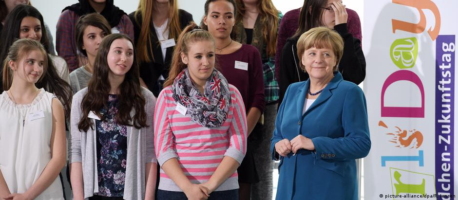 Angela Merkel and young students at a Girls' Day event in 2015 to promote women and girls in STEM (science, technology, engineering, and mathematics) fields