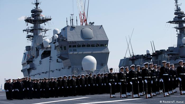 Members of the Japan Maritime Self-Defense Force attend a ceremony for the Izumo helicopter carrier in Yokohama (Reuters/T. Hanai)
