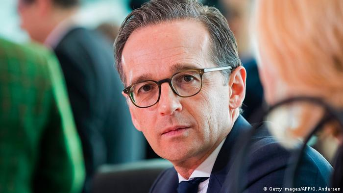 Heiko Maas looks toward the camera (Getty Images/AFP/O. Andersen)